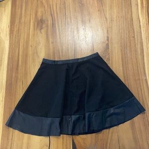Sexy flared mini skirt with leather details